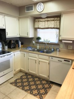 Cute kitchen area with plenty of space to cook for a large family dinner.