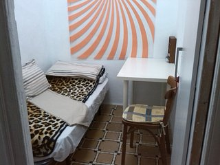 A SMALL ROOM FOR SINGLES, SHARED WITH A FRIENDLY AND HOSPITABLE FAMILY