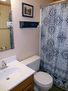 Second bathroom includes tub and shower