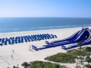 2BR Unit at BEACH FRONT Resort w/ Water Slide Family Activities Spa Pools Gym!