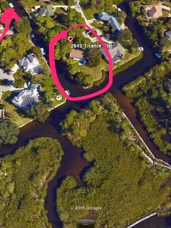 Circled area is the home shown with natural water canals and canal.