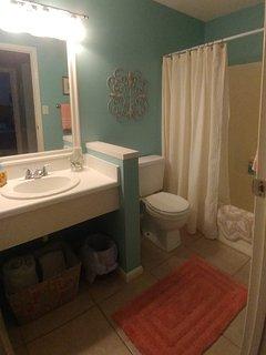 Hall bath adjacent to 2nd bedroom.