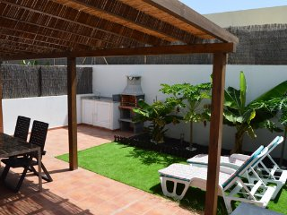 new bright and sunny bungalow with private garden, bbp and shared pool