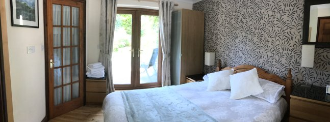 Cysgod Bach bedroom with patio doors and en suite shower room