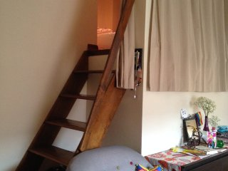 The ladder that leads up to the loft for the guest.