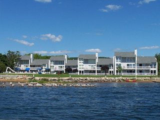 Directly on Lake Charlevoix w/Boat Slip, Pool, Deck, Walkout & Wifi