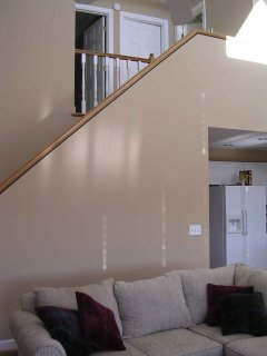 Stairway from Great Room to upper level.  Bedrooms are the 2 doors to the left.  Both nice sized.