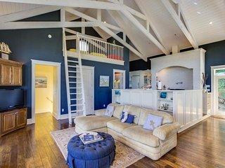 Stunning designer home w/ ocean views, a firepit & direct beach access!