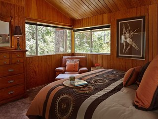 Master bedroom with king sized bed and in-suite bathroom.