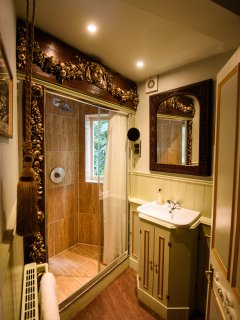 Carved wooden shower... One of a kind and utterly lovely.