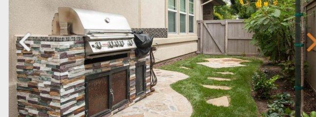 Clean BBQ in fenced yard