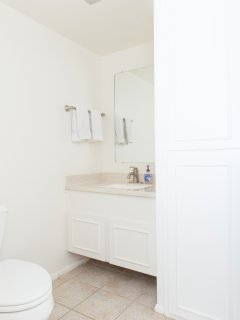 Half Bath - located downstairs just off of the laundry room / kitchen.