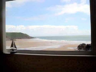 Come stay at a beachside apartment overlooking Caswell Bay on Gower peninsular.