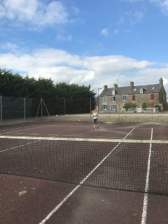 Our tennis courts in the village square, for all residents to use free of charge.