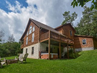 Centrally located log home with fire pit and hot tub!
