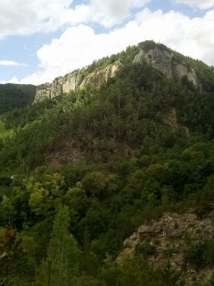 The house sits at the foot of this mountain, where the black mountain  wall is