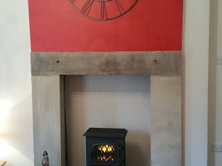 Electric stove in original stone fireplace