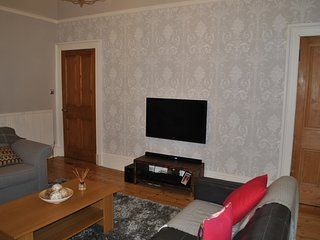 Lounge - with cable TV, Blu Ray player and sound bar.