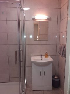 Bright bathroom with spacious shower.