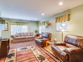 Conveniently located  w/ large deck & fireplace - all the comforts of home!