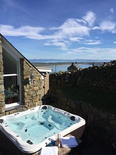 Hot tub with view over bay and Snowdonia