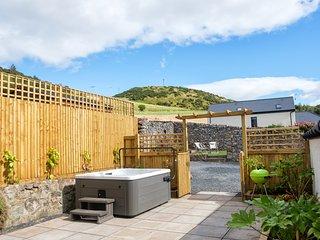 Hot tub, enclosed courtyard, BBQ, 2nd sun trap garden, sun loungers. Herb garden. Safe parking.Views