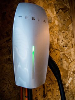 Keep your car warm and dry by parking it in the garage, complete with a Tesla car charger.