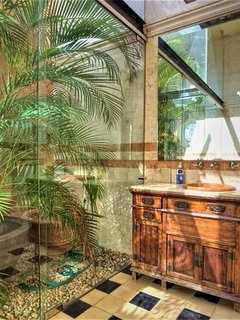Master indoor/outdoor ensuite can be opened to the atrium.