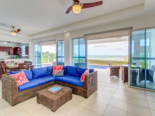 Enjoy ocean views & a private pool at this beautiful home in a gated community