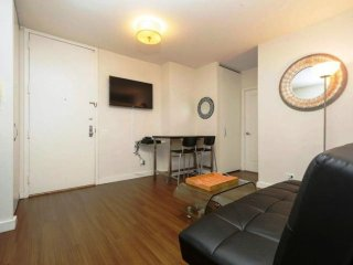N12M-MIDTOWN EAST 1BR APT WITH DOORMAN-AC-GYM