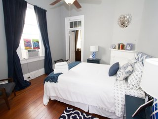 Each bedroom features a comfortable Queen-size bed with plush linens and duvet.