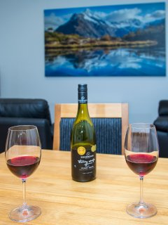 Relax with a drink after exploring Fiordland.