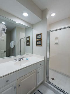 Full en suite bathroom with shower.