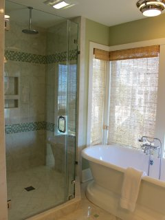Soak in luxury in the tub or rinse in the roomy shower with a rain head.