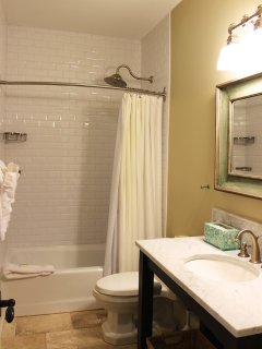 The hall bath sits between these two bedrooms. It has a shower/tub.