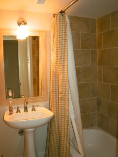 There is a full bath on the first floor - perfect for your guests.