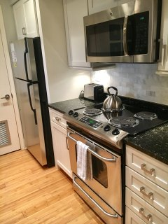 The remodeled kitchen has granite counters and stainless steel appliances.