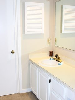 The hall bath is convenient to this bedroom.  It has a large vanity.