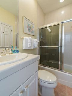 The full bath has a shower/tub with a sliding glass door.