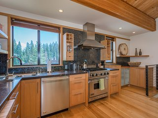 The custom cabinetry and creative backsplash in this second-level kitchen might inspire a new gourmet recipe.