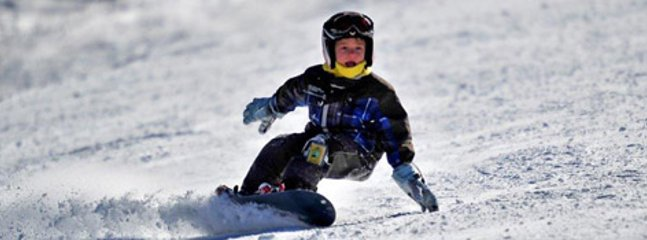 Snowboarding and downhill skiing at two nearby ski resorts.