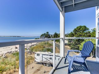 Waterfront corner condo with ocean views - close to beach, bay, & attractions