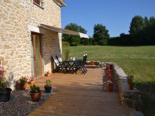 Your fully decked dining and relaxing area with a barbecue