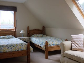 Your room is a lovely space with lots of natural light and beautiful views.
