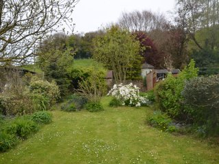 The garden with Cotswold Hill behind it