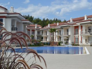 Luxury furnished Garden Apartment in a Peaceful complex ten minutes to beach
