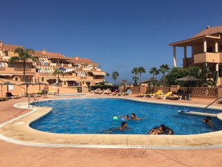 Pool and gardens 2bed apartment, beach and family friendly entertainment