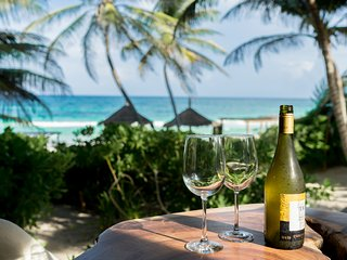Enjoy a glass of wine or beverage on the outdoor patio with breathtaking sea views of the Caribbean.