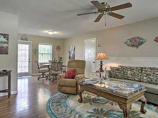 The bright and breezy living area features comfy couches.