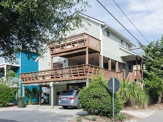 Single family home tucked away on a quiet street with a quick walk to beach